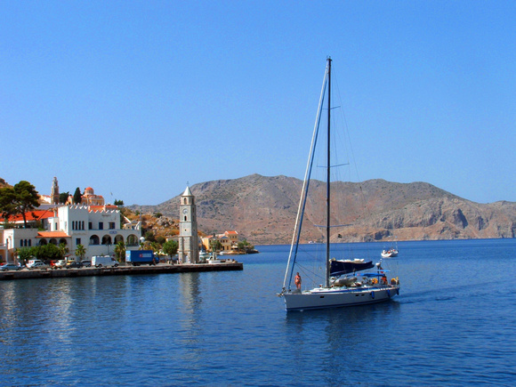 Yatch arriving at Symi Harbour